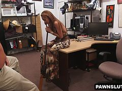 Brunette strips and sucks cock at the pawn shop