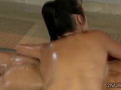 Big boobed Asian beauty gives a teasing Nuru massage